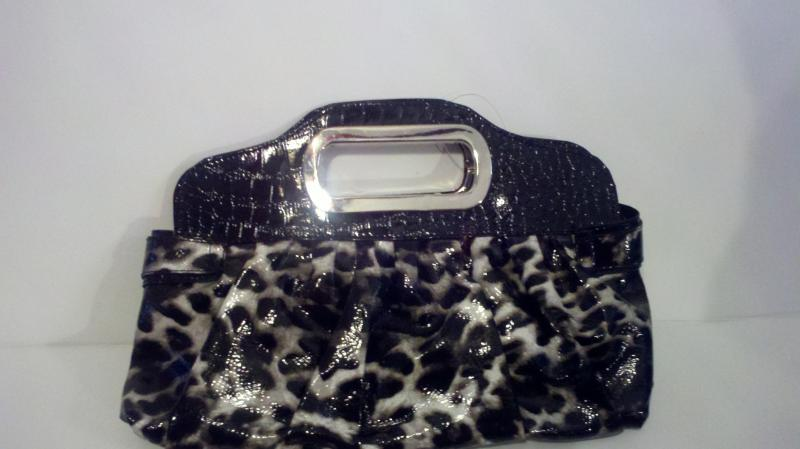 Snake skin like hand clutch handbag