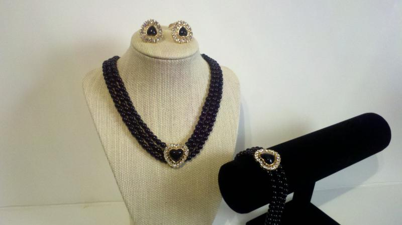 Black beaded necklace and matching earrings