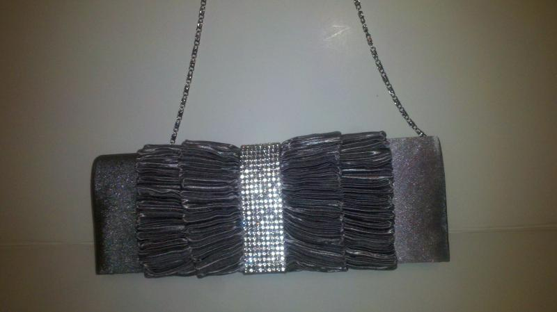 Fancy Purse comes with silver tone arm chain